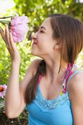 Caucasian teenager smelling flower Stock Photos