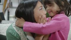 Cute little girl consoles her worried mother Stock Footage