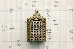 Small building replica on graph paper Stock Photos