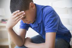 Unhappy Hispanic boy Stock Photos