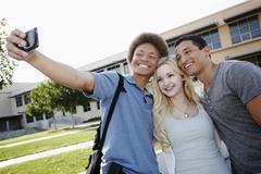 School friends taking self-portrait Stock Photos