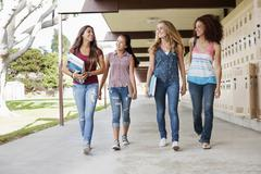 School friends walking in portico Stock Photos
