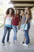 School friends standing in portico Stock Photos