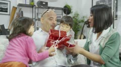 A loving father is given gifts from his wife and children Stock Footage