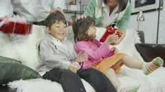 Cute little children are given gifts by their parents Stock Footage