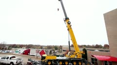 Crane extension being retracted - stock footage