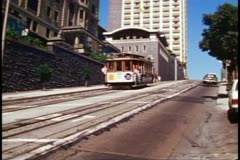 San Francisco, 1970's, Cable Cars, passing on Powell Street at steep angle Stock Footage