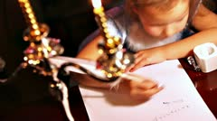 Girl writing with quill pen. Xmas concept Stock Footage