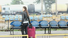 Young couple embracing together in a railway station Stock Footage