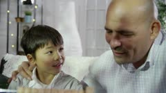 A proud father educating his son at home Stock Footage