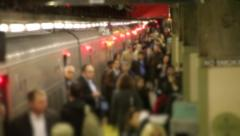 Morning commute anonymous crowd of businessmen and women train slow motion - stock footage
