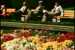 San Francisco, 1970's, Union Square, men seated on a bench Stock Footage