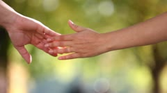 Two lovers hands meeting each other and touching - stock footage