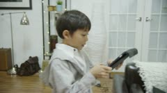 Father and son viewing the screen of a tablet computer Stock Footage