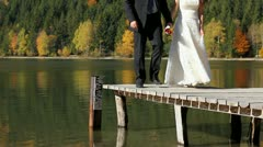 Stock Video Footage of Married couple feet walking on lake pontoon