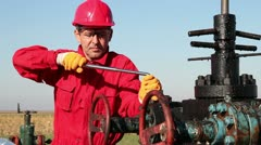 Oil Worker in Action at Oil Well Stock Footage