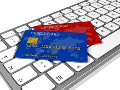 Credit cards on a computer keyboard Stock Illustration