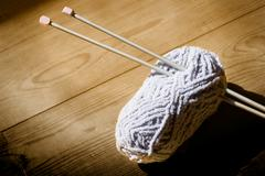 ball of wool and knitting needles - stock photo
