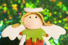 christmas angel in bright green background - stock photo