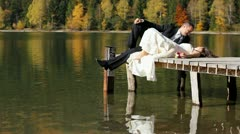 Just married couple laying on mountain lake pontoon an sharing their love - stock footage