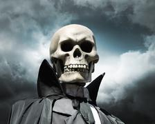Grim reaper. death's skeleton on a cloudy dramatic sky Stock Photos