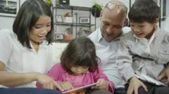 Mother and father bonding with their children at home Stock Footage