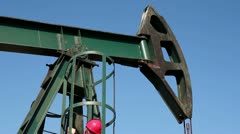 Worker Climbs Up on the Pump Jack Stock Footage