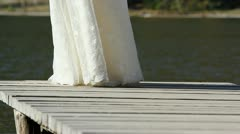Man feet walking to a wooden dock and going to the lady Stock Footage