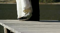Runaway bride feet with sneacker raising on elegant groom shoes for a kiss - stock footage