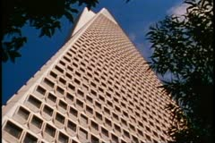 San Francisco, 1970's, The Transamerica Pyramid, top framed in trees Stock Footage