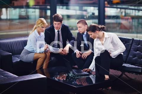 Stock photo of business people in a meeting at office