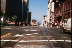 San Francisco, 1970's, Cable Car, POV passby another cable car people hug in Stock Footage