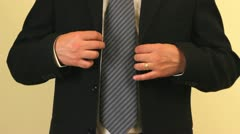 Man arranging his suit before going to business meeting Stock Footage