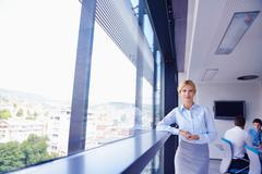 Stock Photo of business woman with her staff in background at office