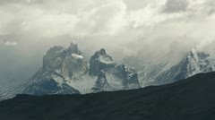 Clouds roll over Torres del Paine in Patagonia - stock footage