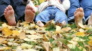 Young family feet in the autumn leaves Stock Footage