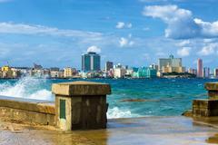 The skyline of havana with a turbulent sea Stock Photos
