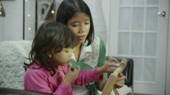 Mother teaching her daughter to count on an abacus - stock footage