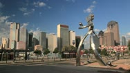 Dallas skyline time-lapse on sunny day w/ clouds & sculpture Stock Footage