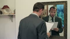Young businessman practice his speech in front of mirror - stock footage