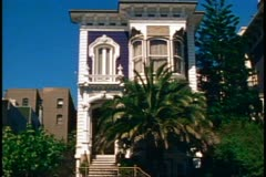 San Francisco, 1970's, Victorian house, still, blue house with palm tree Stock Footage