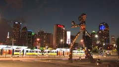 Dallas skyline Time Lapse w/ art and Dart Commuter train Stock Footage