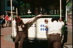 San Francisco, 1970's, two men push cable car off turntable at Market Street - stock footage