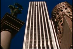 San Francisco, 1970's, modern skyscraper, old column and old building on side Stock Footage