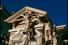 San Francisco, 1970's, painting Victorian house, two painters on ladders Stock Footage