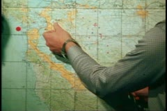 San Francisco, 1970's, map on wall, string marking earthquake fault arc Stock Footage