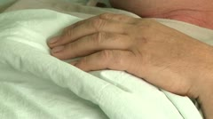 Patient hand in hospital Stock Footage