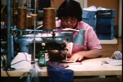 San Francisco, 1970's, sewing denim, medium shot Stock Footage
