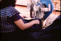 San Francisco, 1970's, Rivet machine, putting rivets into blue jeans Stock Footage