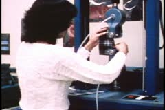 San Francisco, 1970's, research at Levi Strauss, fabric stretching machine Stock Footage